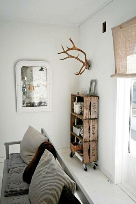 Wood crates into shelves on wheels and the antlers