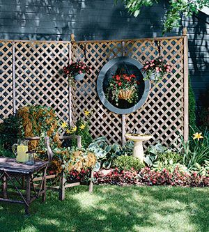 "Create an outdoor ""room"" with wooden lattice gate walls with an added round window."