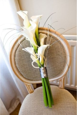 Calla lily bouquet - needs more ribbon around it to hold it safely and the grass is a bit too wild!