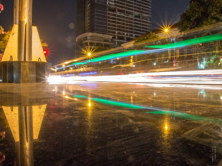 Light Trails - The night closes in along the streets of Ho Chi Minh City as cars leave long light trails in their wake and the highlites shine like diamonds on the pavement