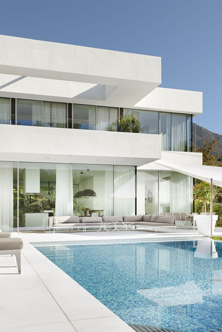Dazzling Architecture House Design with White and Glass Wall also Swimming Pool complete White Marmer Floors using Outdoor Relaxing Ideas