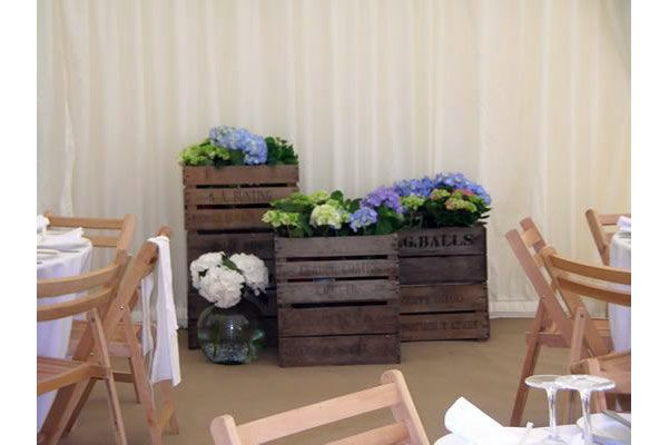 Apple crates make an unusual floral display in a wedding marquee in Rowlands Castle, Portsmouth