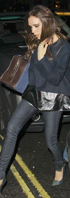 Who made  Victoria Beckham's blue skinny jeans, brown handbag, and leather trim top that she wore in London?