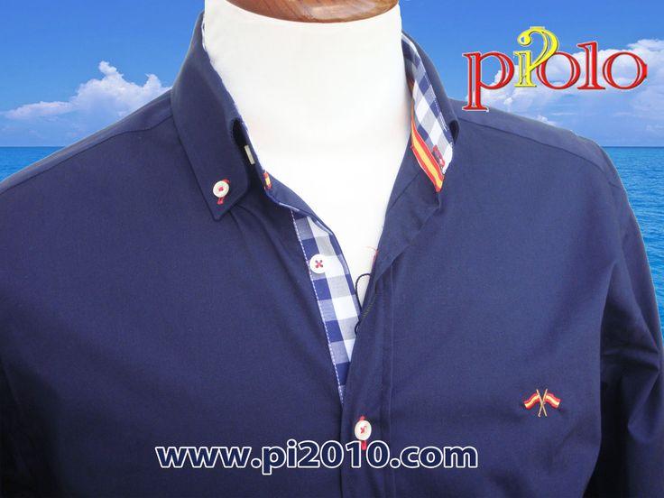 Camisa marino con bandera de España en cuello y pecho. Puños, coderas, botonadura y cuello en cuadros marinos.  Fabricada en España. http://www.pi2010.com/index.php?route=product/category&path=59_75