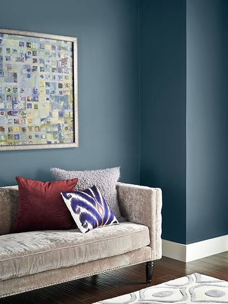 Smooth steel-gray cloaks the walls of this upscale living room where texture-rich furnishings cozy up the space. | @behrpaint NYPD N480-6
