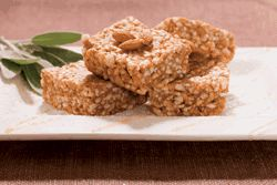 Peanut Butter Rice Crispy Treats - rice cakes, peanut butter (or other nut butter), rice syrup (or could use maple syrup or molasses), raw almonds or other nuts