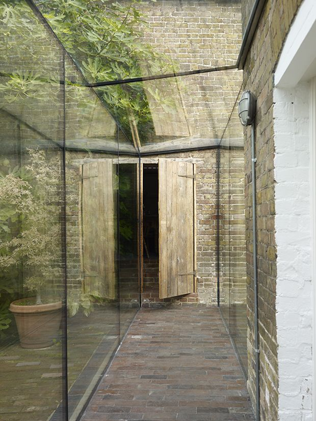 walkway between outbuildings with covered glass corridor