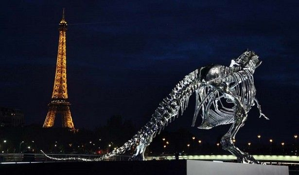 Soaring over the seine river in Paris sits a life-size Tyrannosaurus-Rex sculpture, conceived and constructed by french artist Philippe Pasqua.