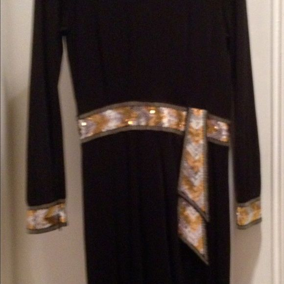 Brand New! Black dress with sequin trim. Never worn! Turtle neck long sleeve dress with gold and silver sequin trim. Size 8/10. Dresses