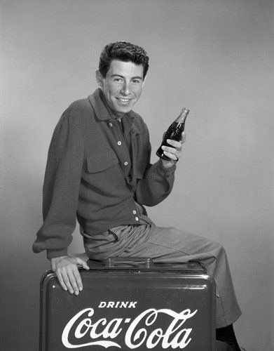Eddie Fisher circa 1955  COKE - Before he left his wife (Debby Reynolds & baby daughter Carrie Fischer) to run off w/ Debby's best friend, Naughty Elizabeth Taylor.  That was the late 50's for ya'. http://www.imdb.com/media/rm3420685824/nm0279472