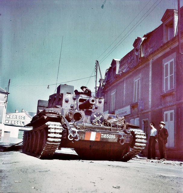 "1944 Normandy, France.  A British ""Centaur Mk IV"" tank in the city streets...."