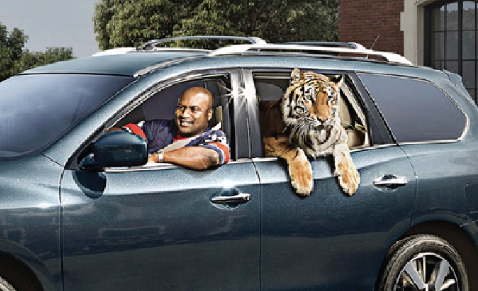 Bo Jackson chauffeuring a tiger in new Nissan ad from thewareaglereader.com RollTideWarEagle.com great sports stories, audio podcast and FREE on line tutorial of college football rules. #CollegeFootball #Auburn