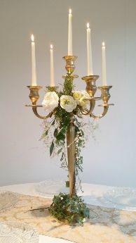 Hire gold candelabras for tall wedding table centres