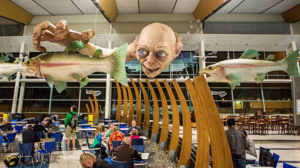 The Middle of Middle-earth A giant sculpture of Gollum, created by local special-effects studio WETA, welcomes the throngs of Hobbit fans at the Wellington Airport in New Zealand. #thehobbit
