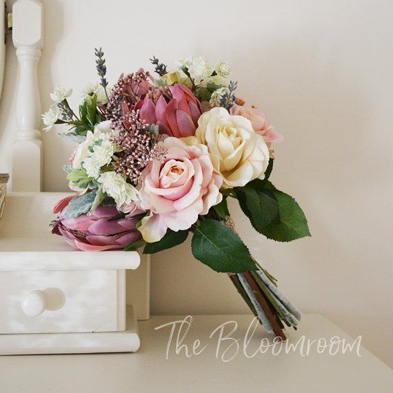 Our vintage inspired Lotti bouquet is packed full of gorgeous flowers. Prince protea, roses in many colours, lavender, astrantia, patrina seeds and dusty miller. A matching bridesmaid bouquet is available in the Etsy store.  #bloomroomdesigns #etsy #vin