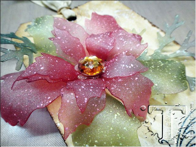 A closeup of a poinsettia from Tim Holtz's 12 Tags of 2013. This is made using a groovy new art film that's heated into shape.