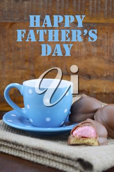Happy Fathers Gift of Coffee and Marshmallow Cookies in natural rustic background, with greeting text.