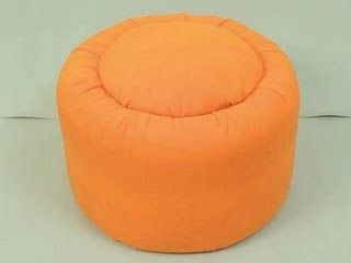 ottoman made out of old tires - reduce landfill waste, plus, cool furniture on the cheap.