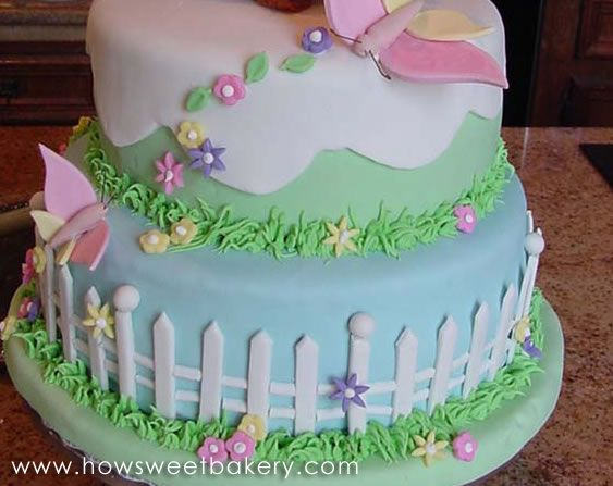 detail for easter cake with picket fence and butterflies cake