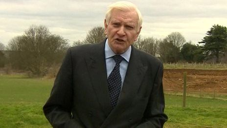 Police search former Tory MP's home