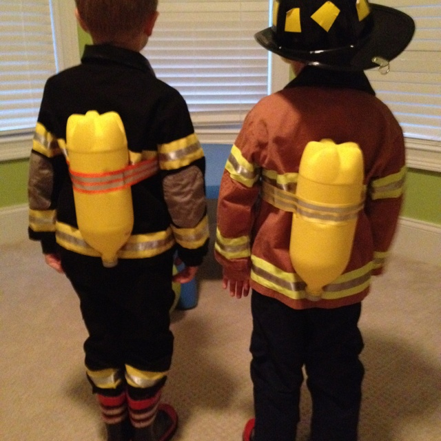 """DIY Fireman """"tanks"""" made from a soda bottle, paint & reflective ribbon. For those hardcore Jr Firefighters."""