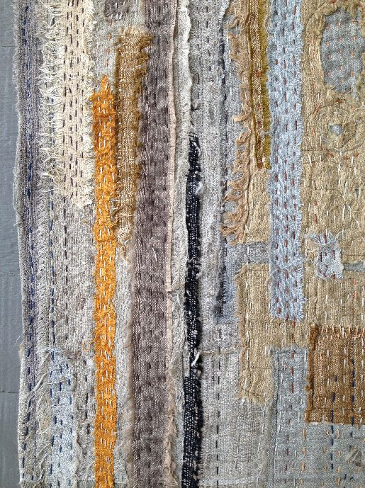 """""""Tear and Repair"""" by X&L. Silk scrap sewn to linen in running stitches."""