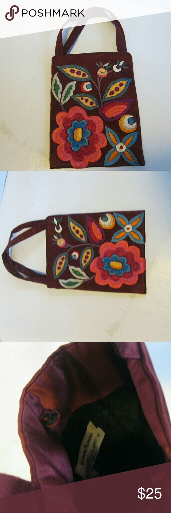 """Megan Park Small Embroidered Handbag Nieman Marcus Megan Park for Nieman Marcus Small Embroidered Handbag. Bag is Maroon silk with embroidered flowers (tag says """"100% silk). Bag measures 5.5"""" x 7.5"""" with a 4.5"""" """"strap drop"""". Bag has a button """"clasp"""" on interior of bag, and a small interior slip pocket. Bag is in good shape - no visible wear.  Bag has the same pattern on both sides. Megan park Bags Mini Bags"""