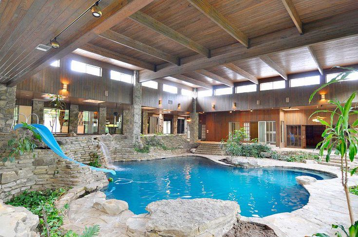 Home indoor pool with slide  20 Homes With Beautiful Indoor Swimming Pool Designs | Indoor ...
