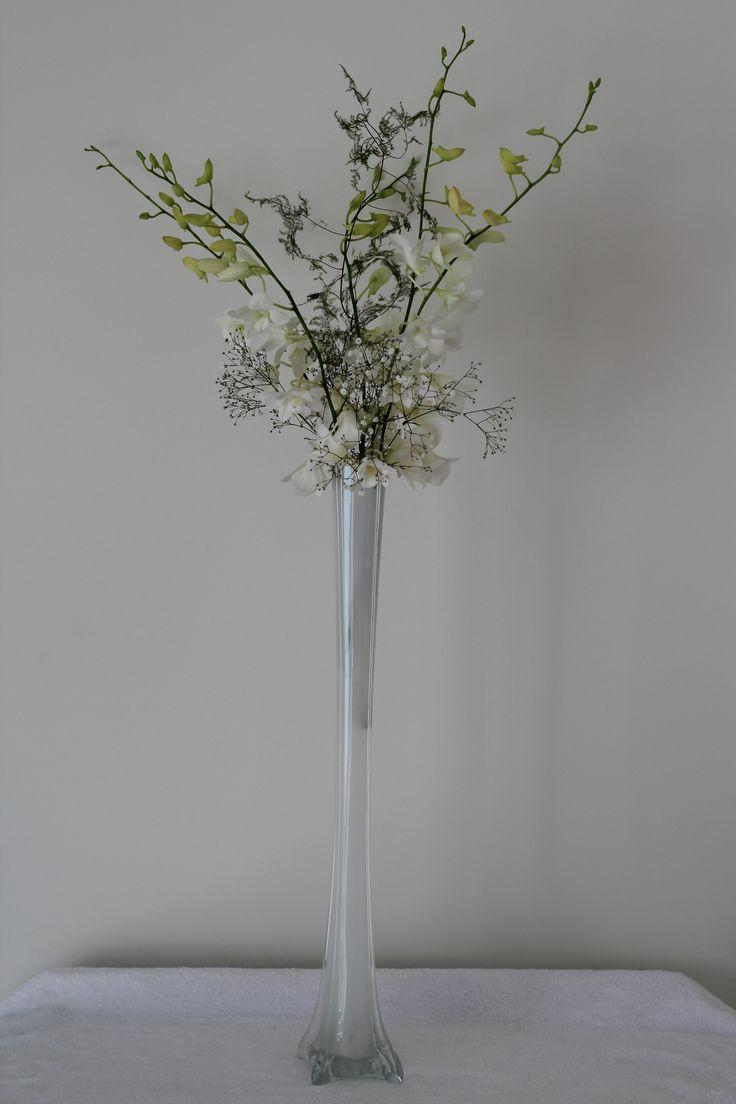 Eiffel Tower vase with orchids http://www.wanakaweddingflowers.co.nz/gallery/