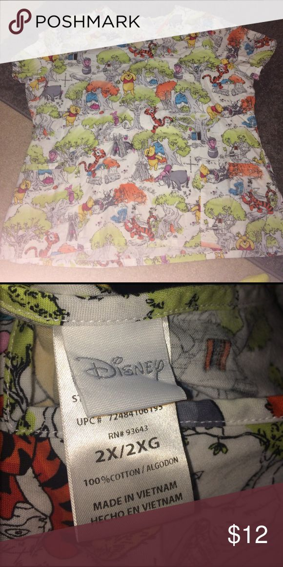 Winnie the Pooh scrub shirt Size 2X worn a few times. All the scrubs for sale in my closet were worn in a daycare, so they are all in great shape! No stains or anything. Disney Tops