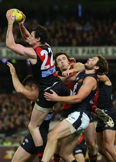 MELBOURNE, AUSTRALIA - JUNE 07: Jake Carlisle of the Bombers takes a mark in the final minute to win the game during the round 11 AFL match between the Essendon Bombers and the Carlton Blues at Melbourne Cricket Ground on June 7, 2013 in Melbourne, Australia. (Photo by Quinn Rooney/Getty Images)