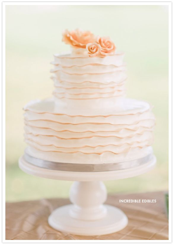 Ivory and peach wedding cake  Oh how we loved the peach trimmed ruffles in this cake by Incredible Edibles. It suited this charming Southern wedding perfectly.  Keywords: #peachweddings #jevelweddingplanning Follow Us: www.jevelweddingplanning.com  www.facebook.com/jevelweddingplanning/