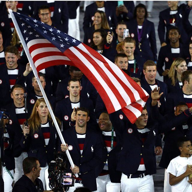 TEAM USA - led by Michael Phelps carries the flag during the Opening Ceremony of the Rio 2016 Olympic Games at Maracana Stadium on August 5, 2016 in Rio de Janeiro, Brazil. (Photo by Cameron Spencer/Getty)