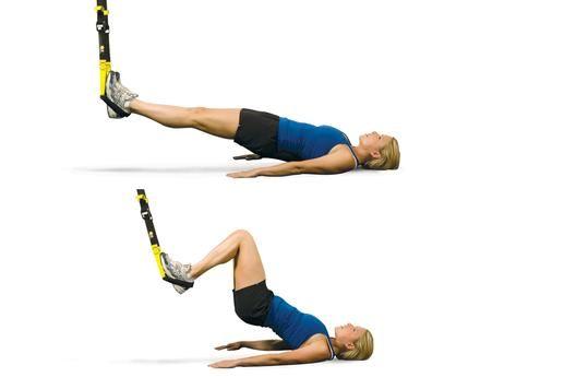 3. TRX Hamstring Curl 3. TRX Bicicleta estacionaria  Fortalecer los músculos isquiotibiales, glúteos y espalda baja con este ejercicio posterior de la cadena. CÓMO HACERLO: Acuéstese boca arriba con las piernas rectas y los talones en el pie acuna directamente debajo del punto de anclaje. Presione sus talones hacia abajo y prepararse su núcleo para levantar sus caderas hacia arriba. Imagínese que usted está realizando un tablón en la espalda. Utilice sus isquiotibiales doblar las rodillas y…