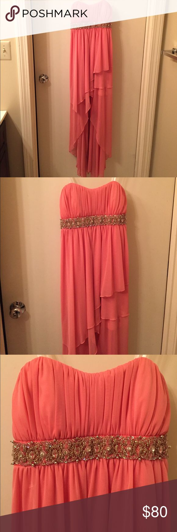 Nordstrom Prom Dress Long beautiful pink / salmon colored beaded strapless gown with layered front. Zipper on the side was professionally added for easier dressing. Small snag in the front, but hardly noticeable (photographed). Only worn once on prom night! Get your prom dress before everyone else so you don't have to stress during prom dress shopping season! MAKE AN OFFER Nordstrom Dresses Prom