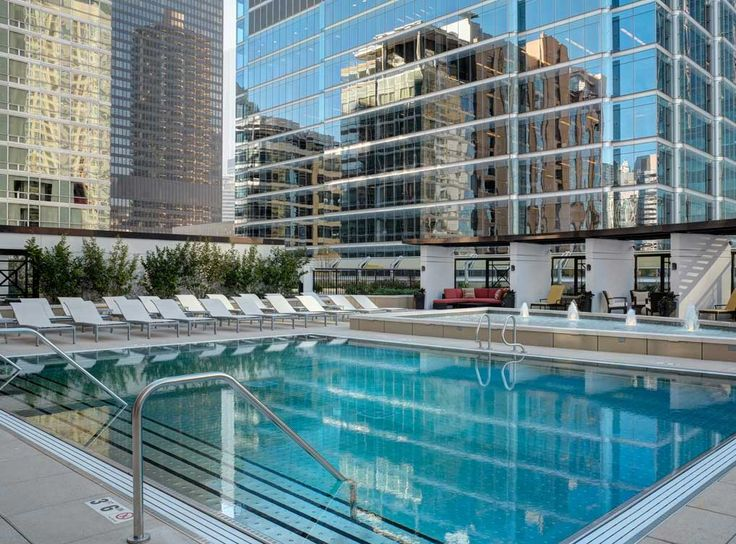 Outdoor Heated Pool With Private Cabanas And TVs At AMLI River North, A  Luxury Apartment