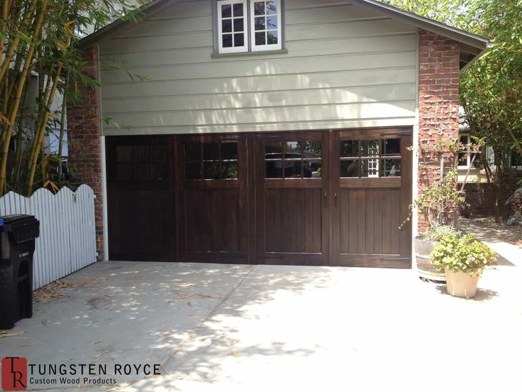 Carriage DoorsAt Tungsten Royce we apply high standards of craftsmanship, finish, and installation for our carriage garage doors. We provide real carriage doors to both homeowners and contractors. Unlike overhead garage doors, real carriage doors swing outward (or inward) on hinges. They can slide sideways, like barn doors, with the right hardware. They