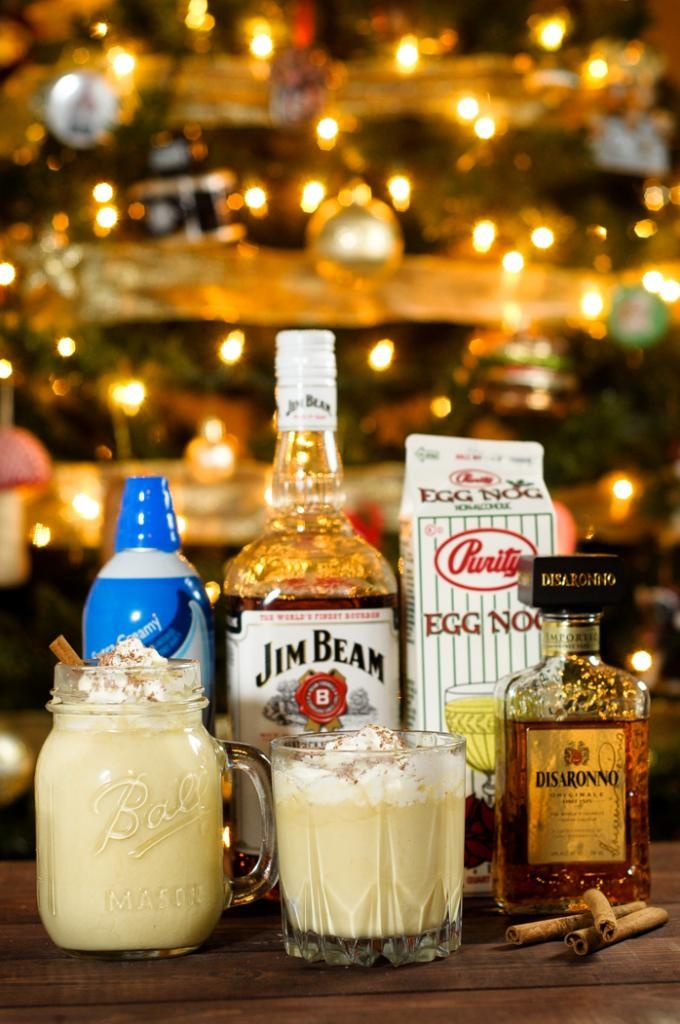 LumberJill    1 oz Jim Beam (or bourbon of your choosing!)  .5 oz Disaronno (or any amaretto liqueur)  Fill Eggnog  Top with whipped cream  Sprinkle with chocolate shavings  Garnish with cinnamon stick