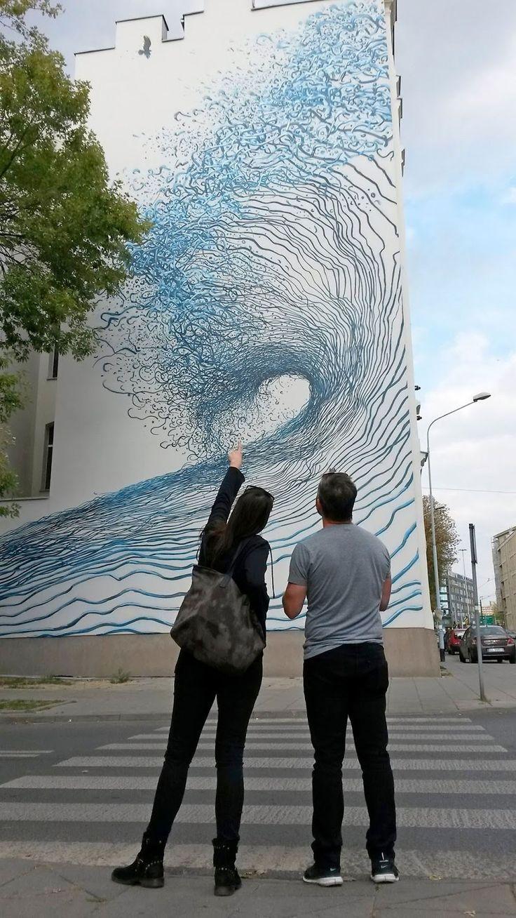 Street Artist DALeast Unveils a New Impressive Mural in Lodz, Poland