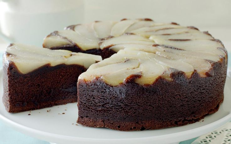 Delight your family and friends with this beautiful upside down dessert served fresh out of the oven. Indulge your senses with decadent chocolate cake topped with juicy, sweet tender pears. Recipe by the Australian Women's Weekly.