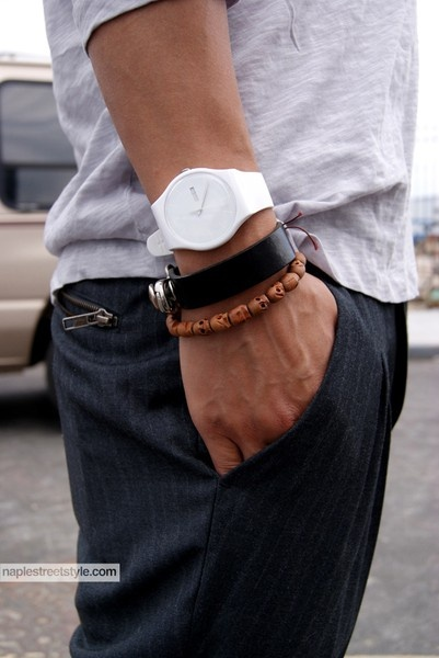 Leather bracelet, beads, and simple watch.
