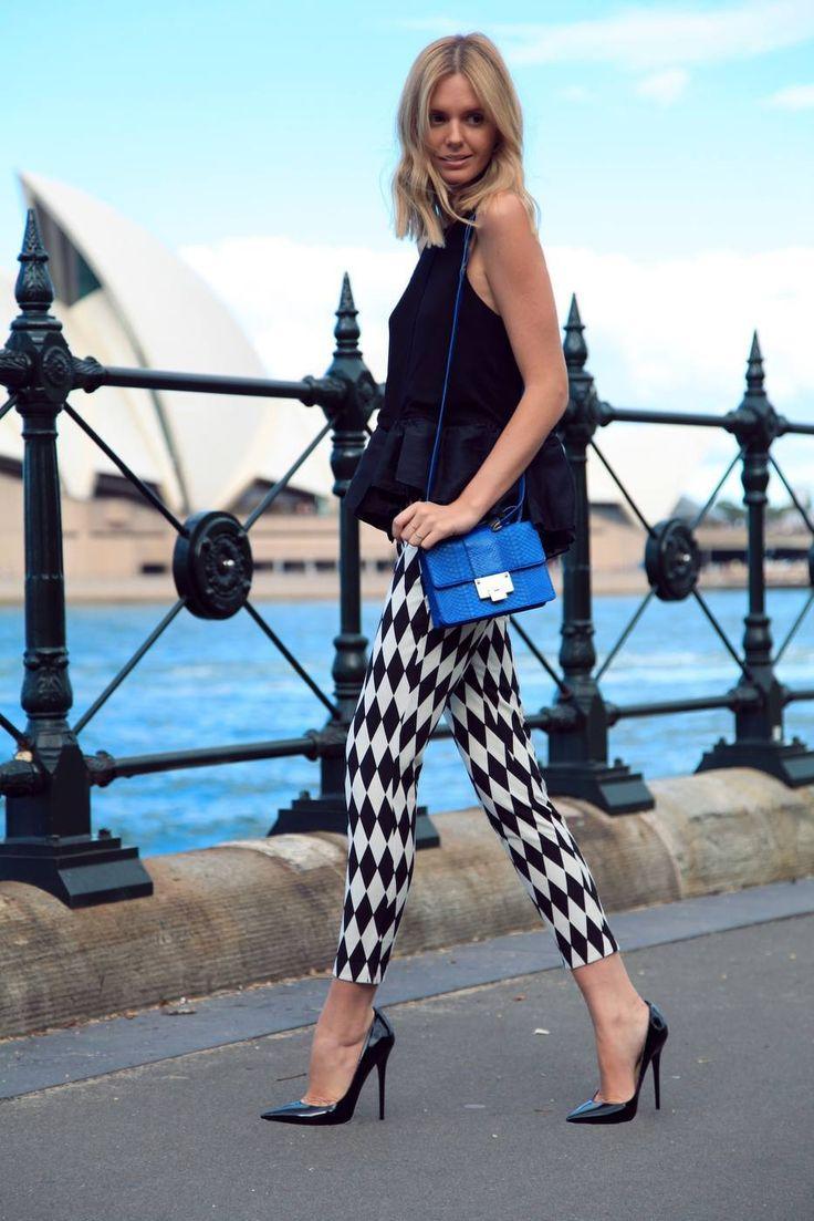 Black and white leggings, black peplum shirt, blue handbag, black heels. From lolobu.tumblr.com. Street style fashion