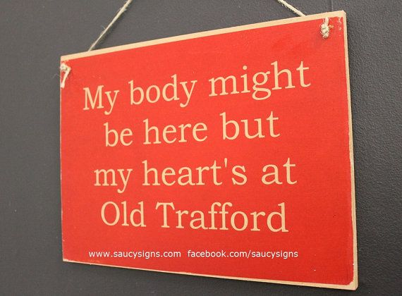 My body might be here but my heart's at Old Trafford Manchester United - EPL - English football and soccer sign.