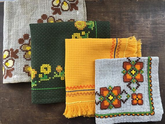 Cross Stitched napkin Set of 4 Embroidered Orange brown Green floral napkin set Assorted Square napkin set This is a beautiful cross stitch Scandinavian napkin set from the late 60s - early 70s - I dont know exactly how old it is Measurements: Approx 30 x 31.5cm; 38.5 x 37.5cm; 40.5cm x 40cm; 37 x 36cm Condition: good
