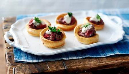 Mini Yorkshire puddings with roast beef and horseradish cream.
