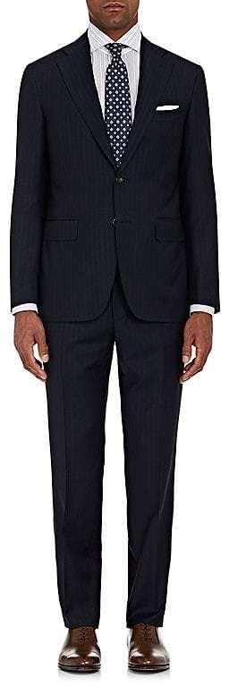 Celebrated for their meticulously tailored silhouettes, Canali suits and sportcoats are made in Italy with a soft construction for a natural look. Canali's navy and white pinstriped Capri suit is crafted of Super 130s worsted wool suitable for wearing year-round. Made in Italy, it features a two-button closure, lightly padded shoulders, and a slim fit. Jacket. Slim fit. Two-button closure. Side vents. Notch lapels.