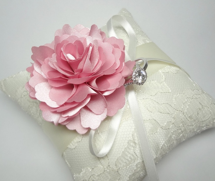 Lovely wedding ring pillow Indian Pink  Bloom on Cream lace Ring Pillow. $35.00, via Etsy.