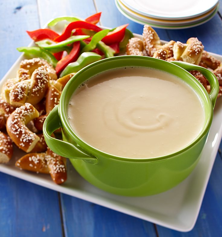 An Oktoberfest staple — this Creamy Queso Dip has a hint of mustard and pale ale beer.