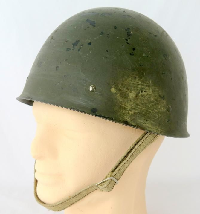 """WW2 Finnish army M40 steelhelmet. Helmet has a second layer of paint, WW2 period paint. Helmet has a original pins,original liner and chinstrap. Unusual webbing chinstrap which is uncommon. Helmet is stamped """"72 W"""", which means helmet size and W= Wärtsilä."""