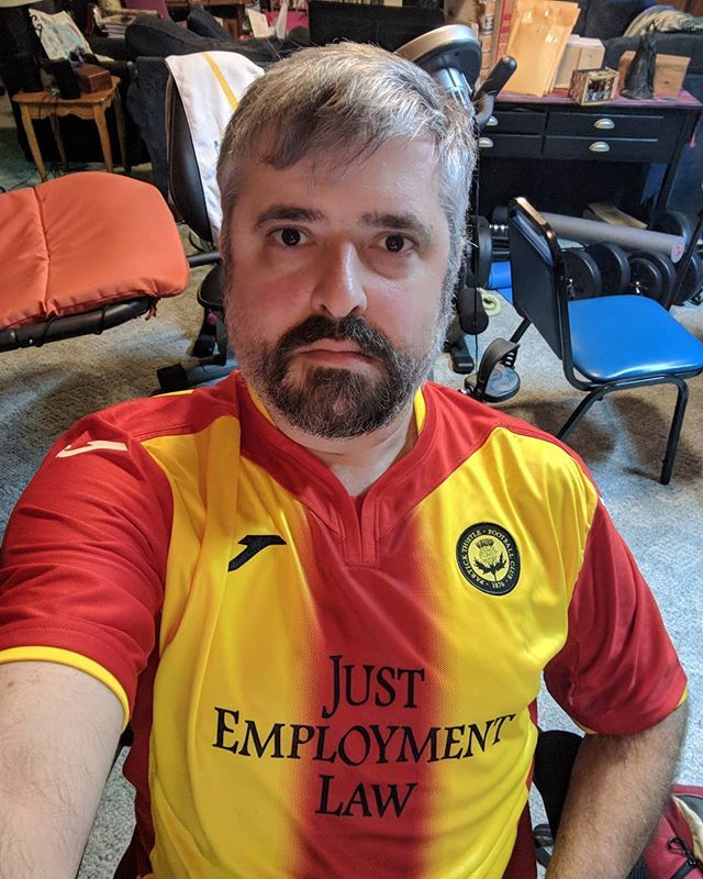 The thing about wearing a Scottish football shirt (in this case from Partick Thistle FC of Glasgow) is that you wind up with the name of the sponsor in BIG letters across your chest.  @thistletweet